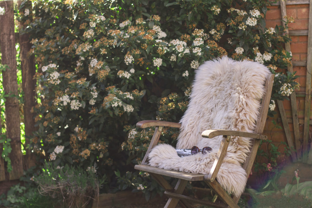 Friluftsliv - sheepskin rug on an outside chair